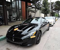 black maserati sports car casa ferrari carmel the auto blonde