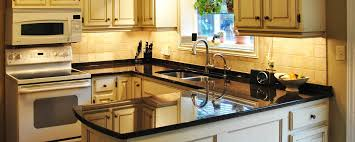 kitchen glass backsplash tile beige granite countertops cabinet