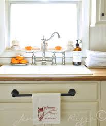 use a towel hanger on that false drawer for your dish towels in