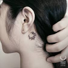 small floral moon tattoo behind the left ear tattoo artist zihwa