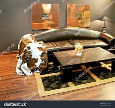 black leather sofa cowhide cover pillows stock photo 13956148