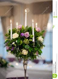 flowers and candles table center piece stock photos image 24296503