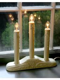 electric candle lights for windows in new england houses glow with candles in every window all holiday