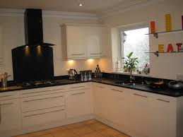 cream kitchen ideas brown cabinets and black countertops fancy home design