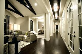 Living Room With Grey Walls by Dark Living Room With Grey Walls And Sofa On Wood Floorgray Floor