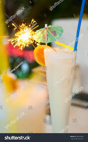 martini glass with umbrella pina colada coconut white rum cocktail stock photo 389409550