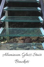 glass stair treads add impact to a dramatic landscape water