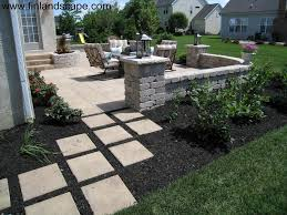 outdoor living area with paver patio seatwall pillars stone