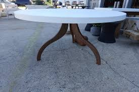 round concrete dining table with tripod metal base mecox gardens