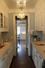 top 25 best galley kitchen design ideas on pinterest galley amazing wallpaper stunning light fixtures and richly colored wood floors make this small kitchen a design standout you can see more of this kitchen and