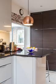 modern kitchen curtain ideas quartz curvey end black quartz countertops luxury brass light pendant