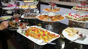 Restaurant Buffet Table by Assortment Of Desserts On Catering Buffet Restaurant Guests