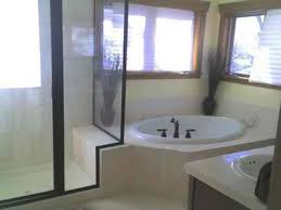 bathroom with corner tub and modern shower