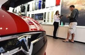 car junkyard antioch ca tesla reveals start date for model 3 deliveries sfgate
