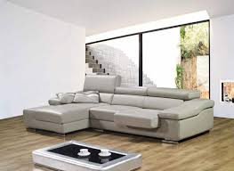 gray walls combined with black sofa for cozy living room idea
