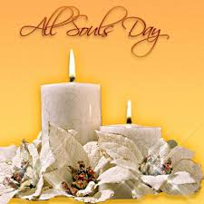 all souls day candles and flowers