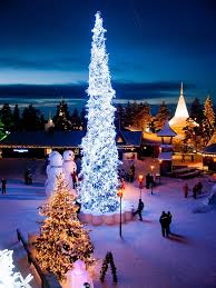 christmas tree illuminated at night in santa claus village