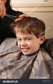 cute young boy getting haircut stock photo 72755164 shutterstock
