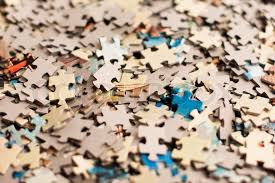 the background unsolved bunch of jigsaw puzzles pieces stock