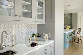 herringbone kitchen backsplash butler s pantry with herringbone backsplash and gray glass front