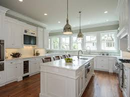white kitchen cabinets with oak trim white varnished wooden wall