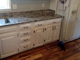 decorating white wooden kitchen cabinet with black handle and