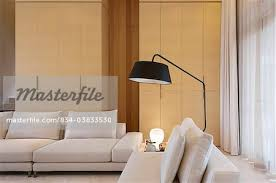 over the couch lighting large floor l over sofa in modern home stock photo masterfile