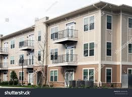 modern 3 story apartment condominium building stock photo