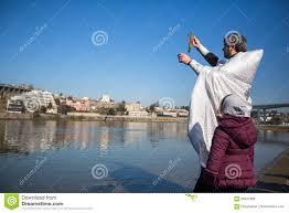 celebrating baptism of jesus and epiphany bathing in douro river