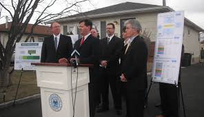 lipa pushes green home remodeling program long island press officials in front of house that was first to join the pilot program