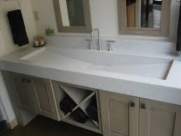 rectangular white vanity trough sink on cream ceramic tiled wall