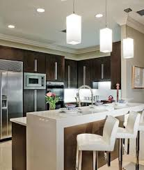 mini kitchen design with bar counter and modern black stool and