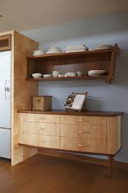 ingenious hand crafted kitchens from johnny grey view in gallery traditional dresser next to the fridge gives the space a warm cozy appeal
