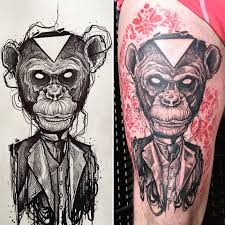 roaring monkey face tattoo on forearm