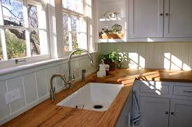 beige reclaimed oak wood countertops for white l shaped kitchen
