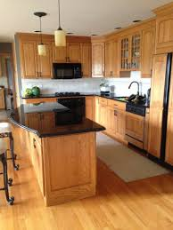 should i stain or paint my oak cabinets should i paint my golden oak cabinets