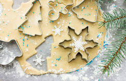 snowflake cookie cutter on blue snow royalty free stock image