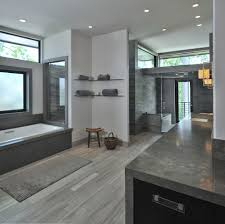 enchanting decorating ideas with frosted windows for bathrooms incredible design ideas using rectangular brown rugs and white bathtubs also with grey granite countertops