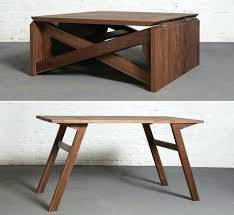 collapsing dining table coffee table to dining table called the transforming coffee table
