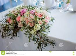 Table Flowers by Flower Arrangement On The Table Flowers And White Tablecloth