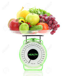 healthy eating kitchen scale with fruits and vegetables stock