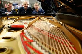 hancher group travels to new york for new steinway piano the gazette