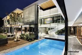 swimming pool at u shaped house design by saota and antoni