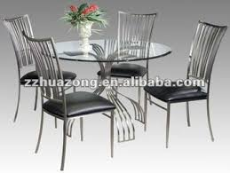 glass metal dining table ashley round glass top steel dining table and dining chairs buy