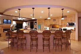 kitchen white hanging lamp brown kitchen cabinets brown bar