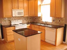 dark kitchen cabinets light countertops mosaic tiles for