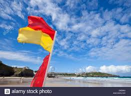 Cornwall Flag Lifeguard On Duty Warning Flags Yellow And Red On Newquay Beaches