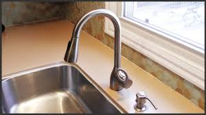 where is the aerator on a kitchen faucet removing hard water deposits from a faucet head youtube