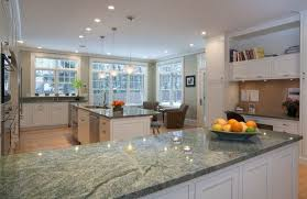 white kitchen cabinets with green countertops costa smeralda granite with white cabinets green granite