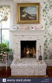 fireplaces white painted brick fireplace in kitchen eating area